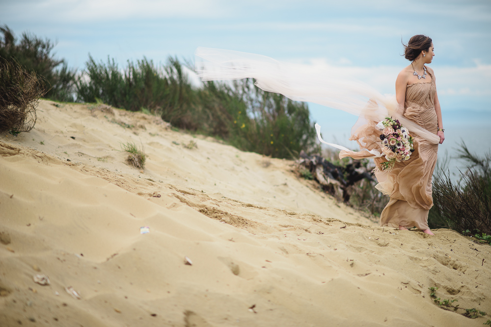 Bride in Wind on CliffColours of the Wind Erin Wallis Photography West Coast Weddings Magazine