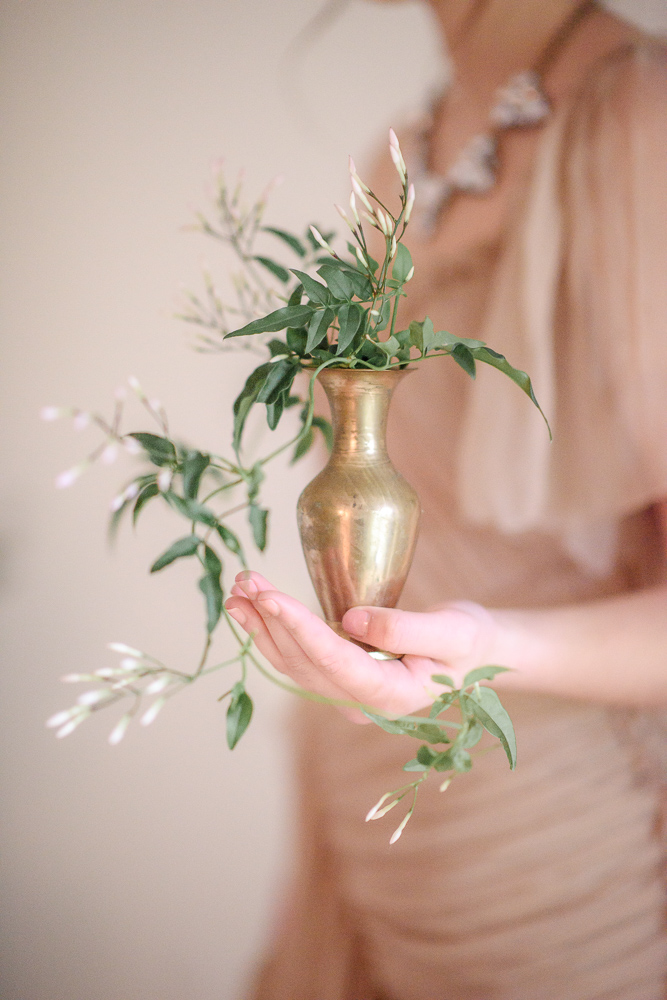 Green ivy in vase Colours of the Wind Erin Wallis Photography West Coast Weddings Magazine