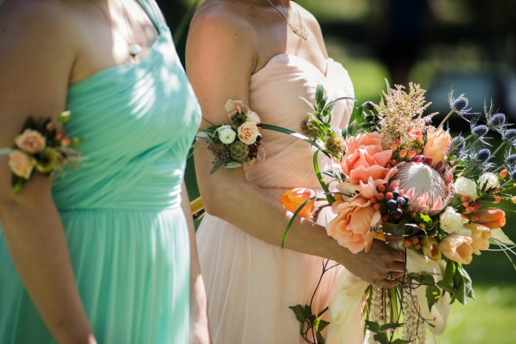 Bridesmaids in Pastels with Bouquet of Peach Roses Brown's the Florist by Funkytown Photography West Coast Weddings