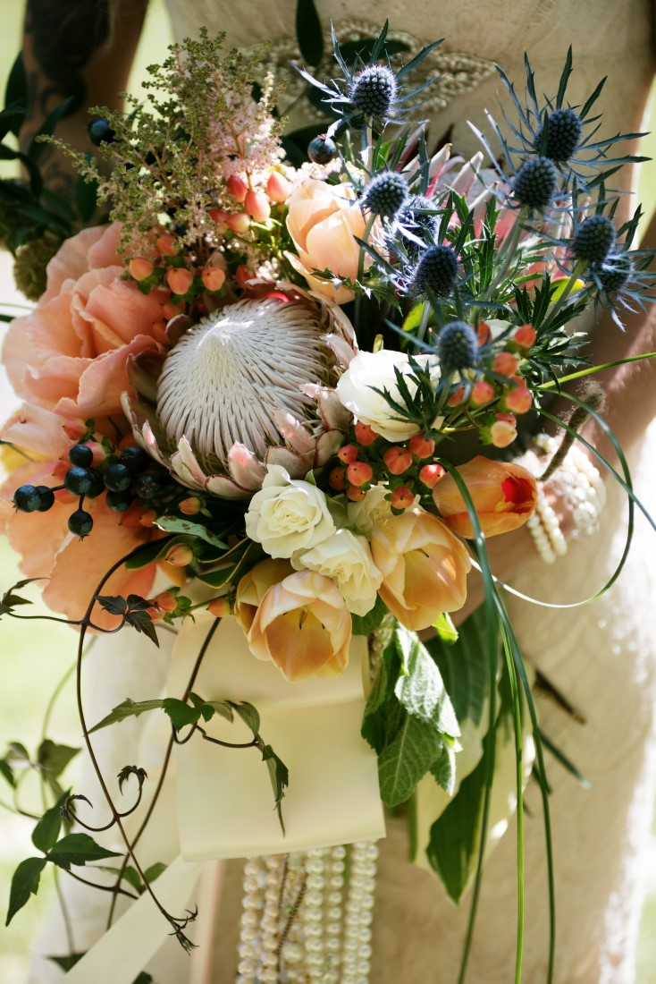 Bride with Bouquet of Protea and Peach Roses Brown's the Florist Victoria Wedding