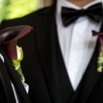 West Coast Weddings Magazine LGBTQ Two Grooms Boutonnieres Dark Calla Lilies