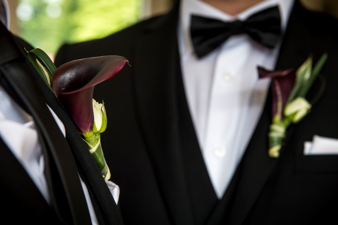 West Coast Weddings Magazine LGBTQ Two Grooms Boutonnieres Dark Calla Lilies