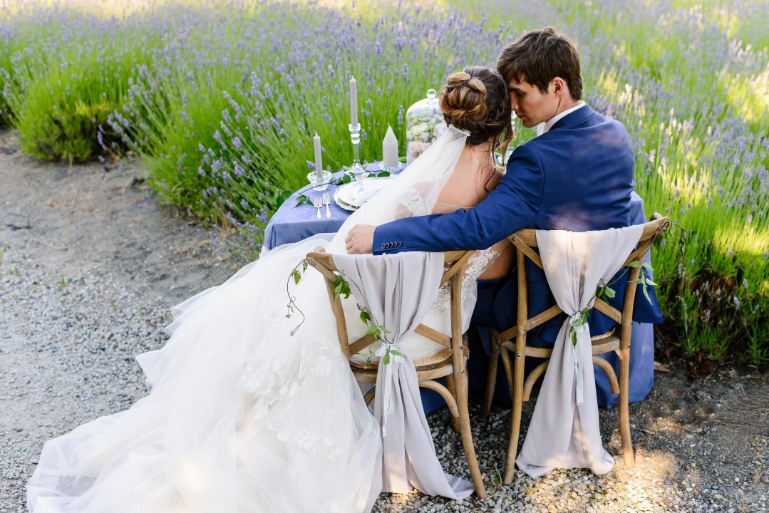 Couple hugging at sweetheart table Kristen Borelli Photography