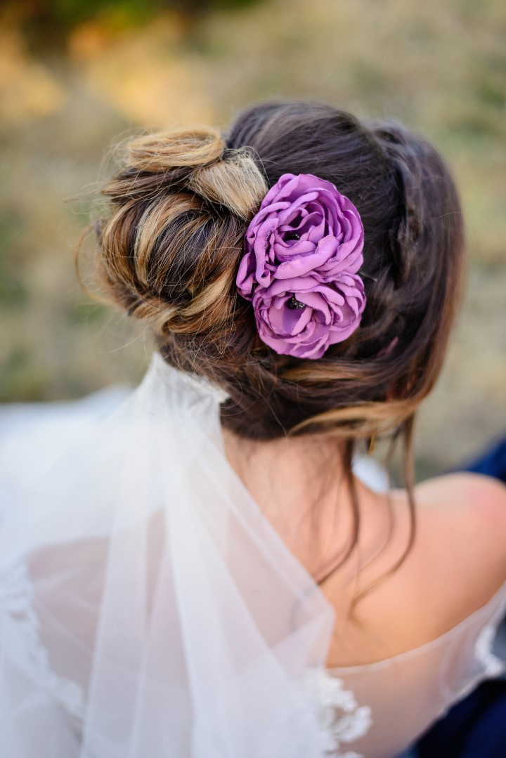 Flowers in brides hair in field of lavender Lace & Lavender Hair Style