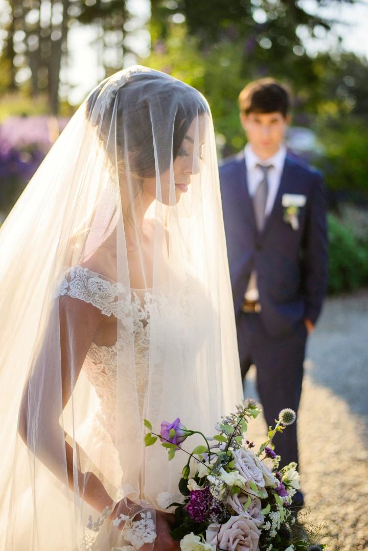 Veil over brides face in lavender field Kristen Borelli Photography