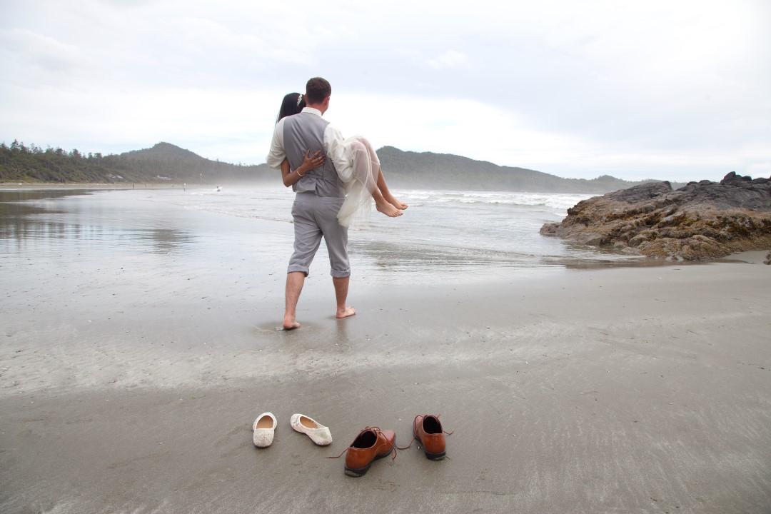 Carrying the Bride Across Beach West Coast Elope Vancouver Island Wedding Magazine