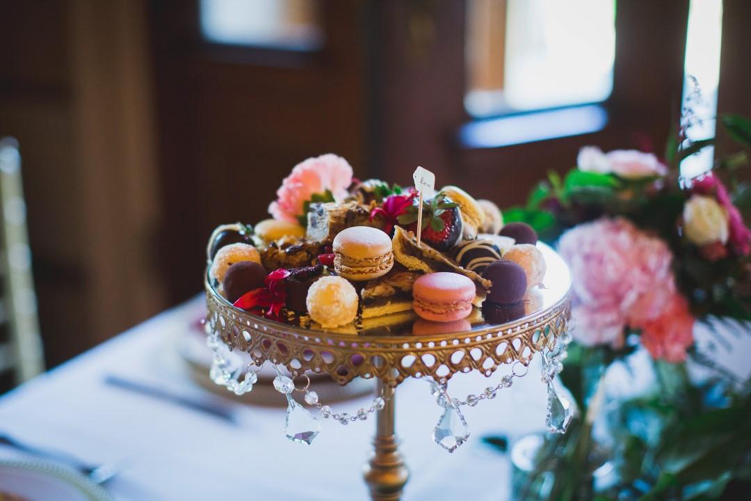 Pastel Coloured MacaroHatley Castle West Coast Weddings Magazinens on Cake Plate