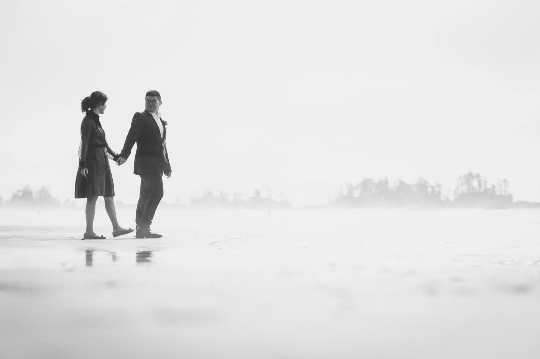 Newlyweds HOlding Hands West Coast Elope Vancouver Island Wedding Magazine