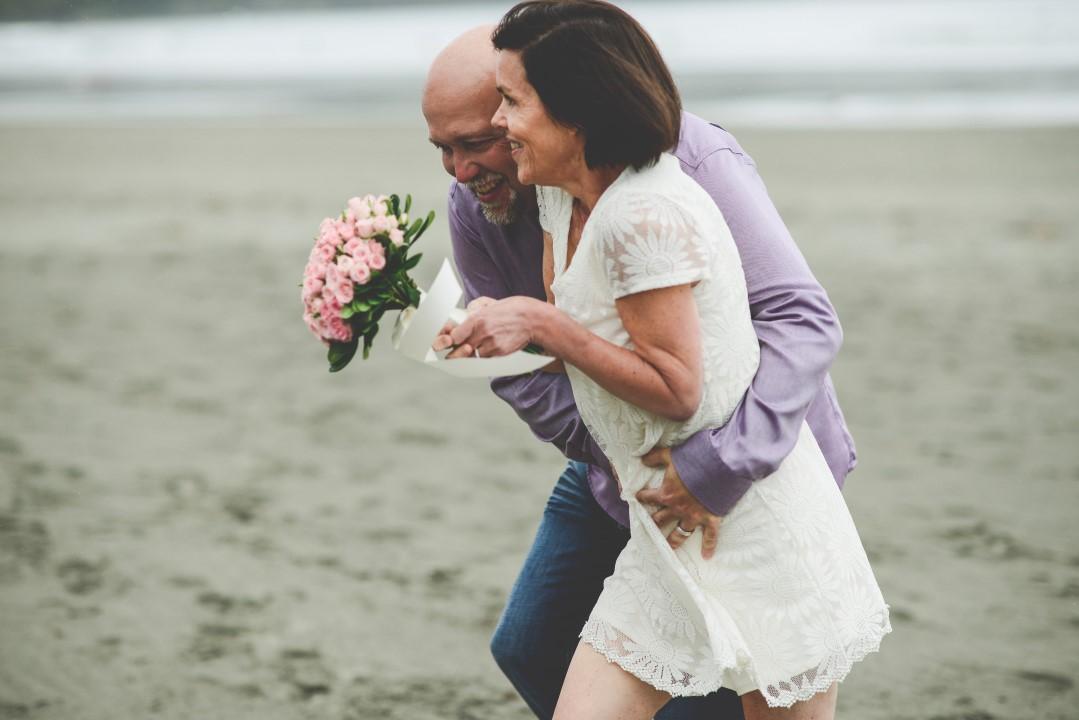 Newlyweds on Beach West Coast Elope Vancouver Island Wedding Magazine