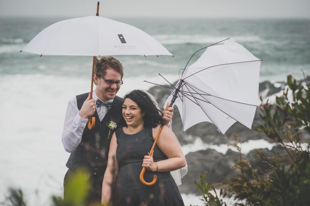 Newlyweds and UmbrellasWest Coast Elope Vancouver Island Wedding Magazine