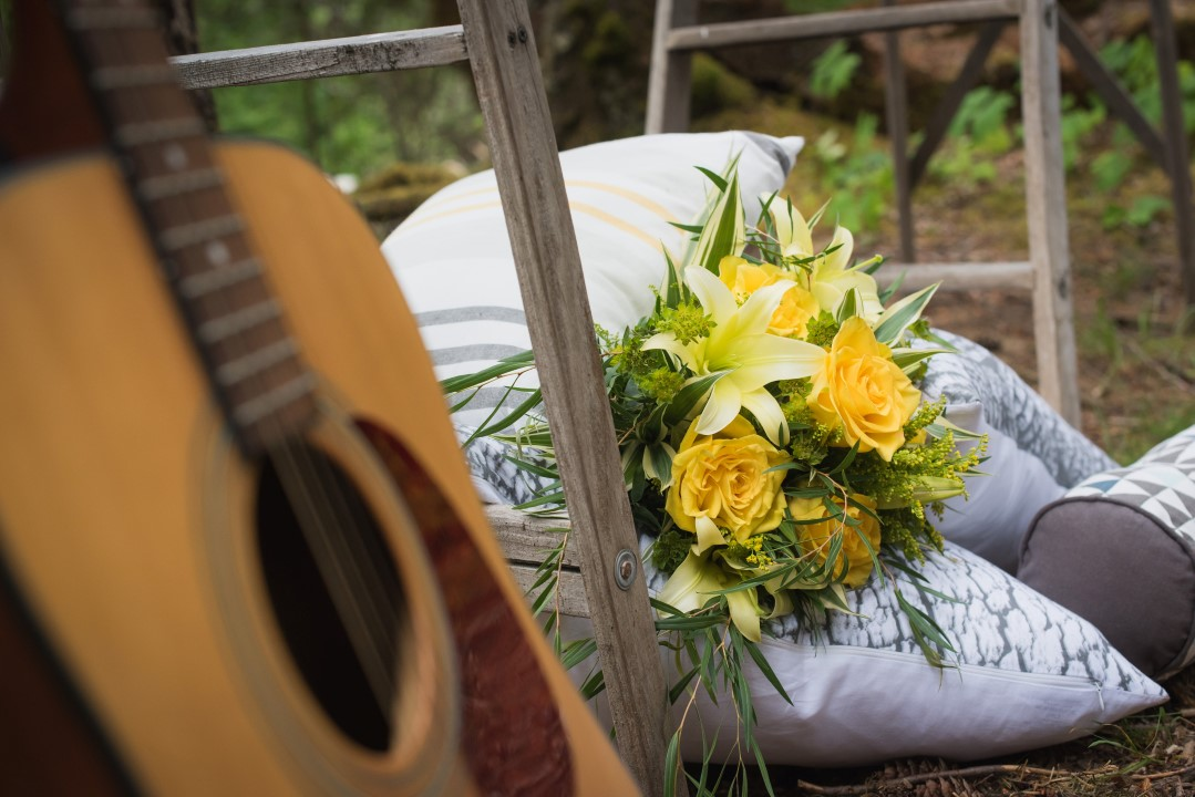 Guitar and Bouquet of Yellow Flowers River Romance Boho Wedding