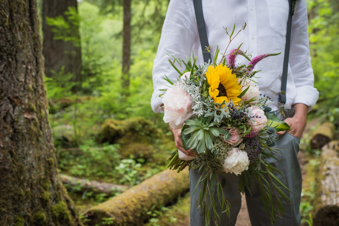 Groom Holding Bouquet Thrifty Foods Floral West Coast Weddings Magazine