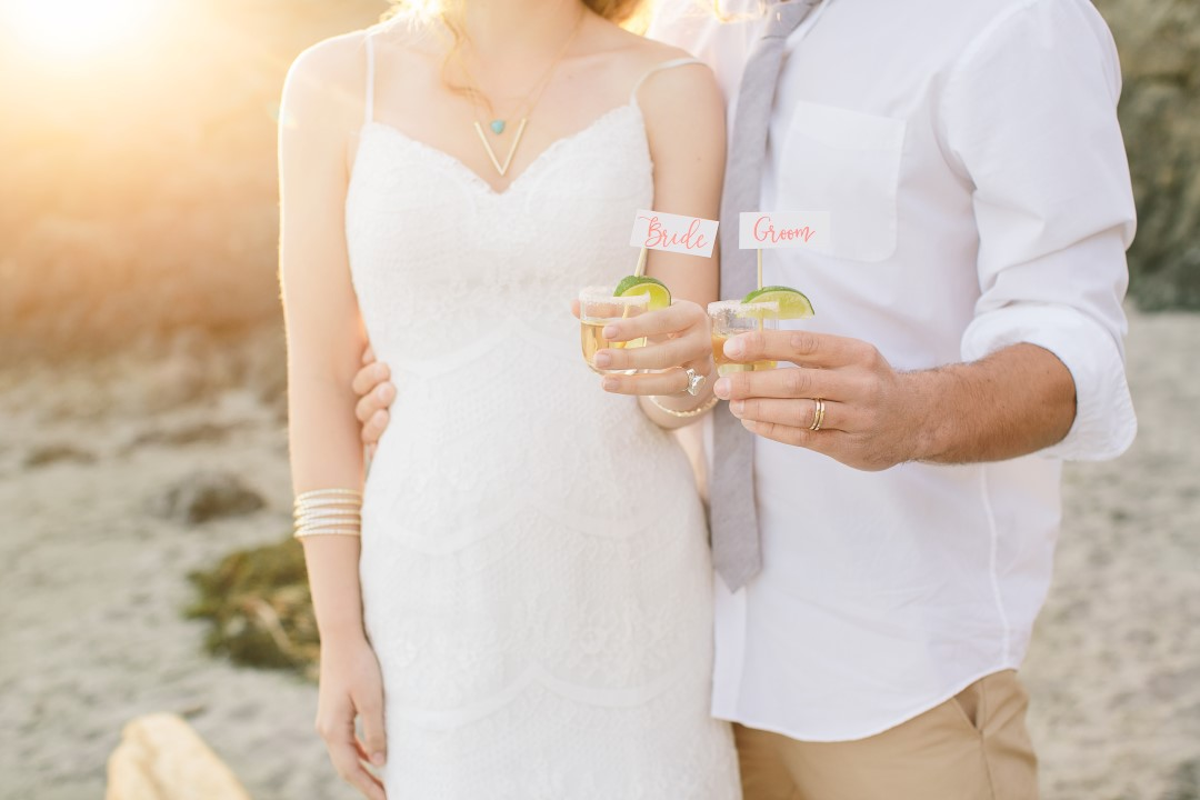 Newlyweds drinking champage on the beach Vancouver Island Wedding Magazine