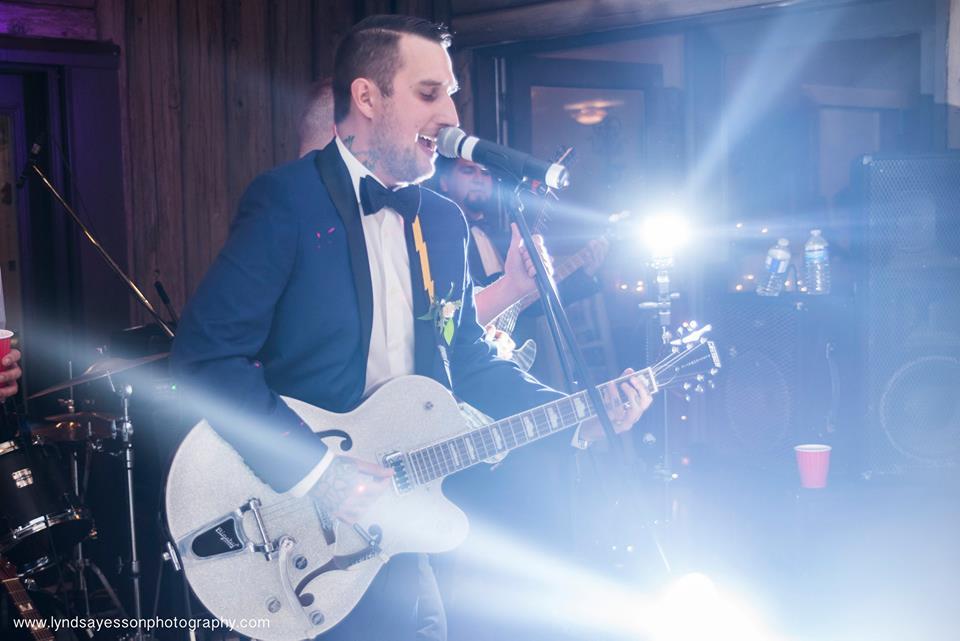 Groom Playing Guitar Ocean View West Coast Weddings Magazine
