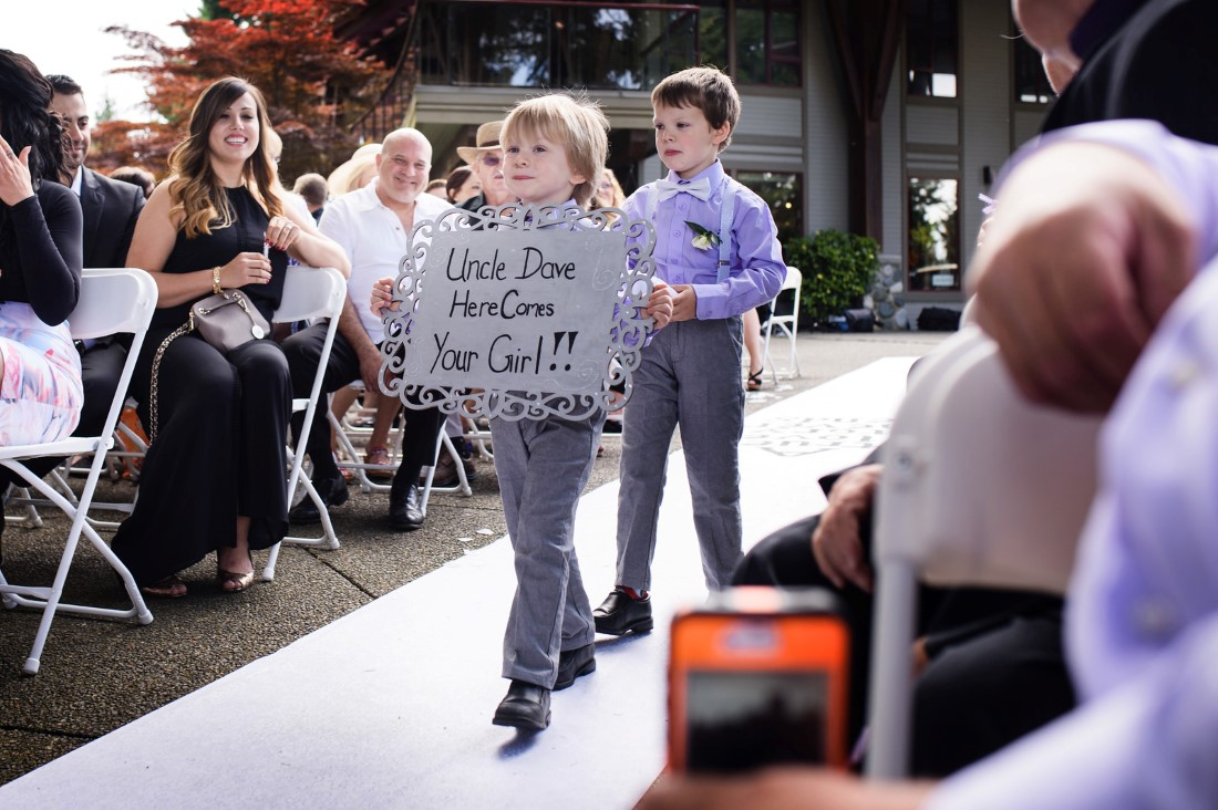 Ring Bearer Carrying Sign Crown Isle Love Story on Vancouver Island