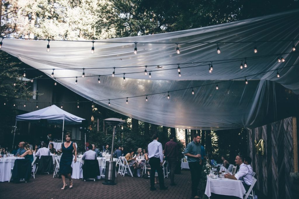 Outdoor reception with gauze roofing and lights