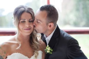 Bride kissed by groom Spring Romance Wedding Vancouver Island