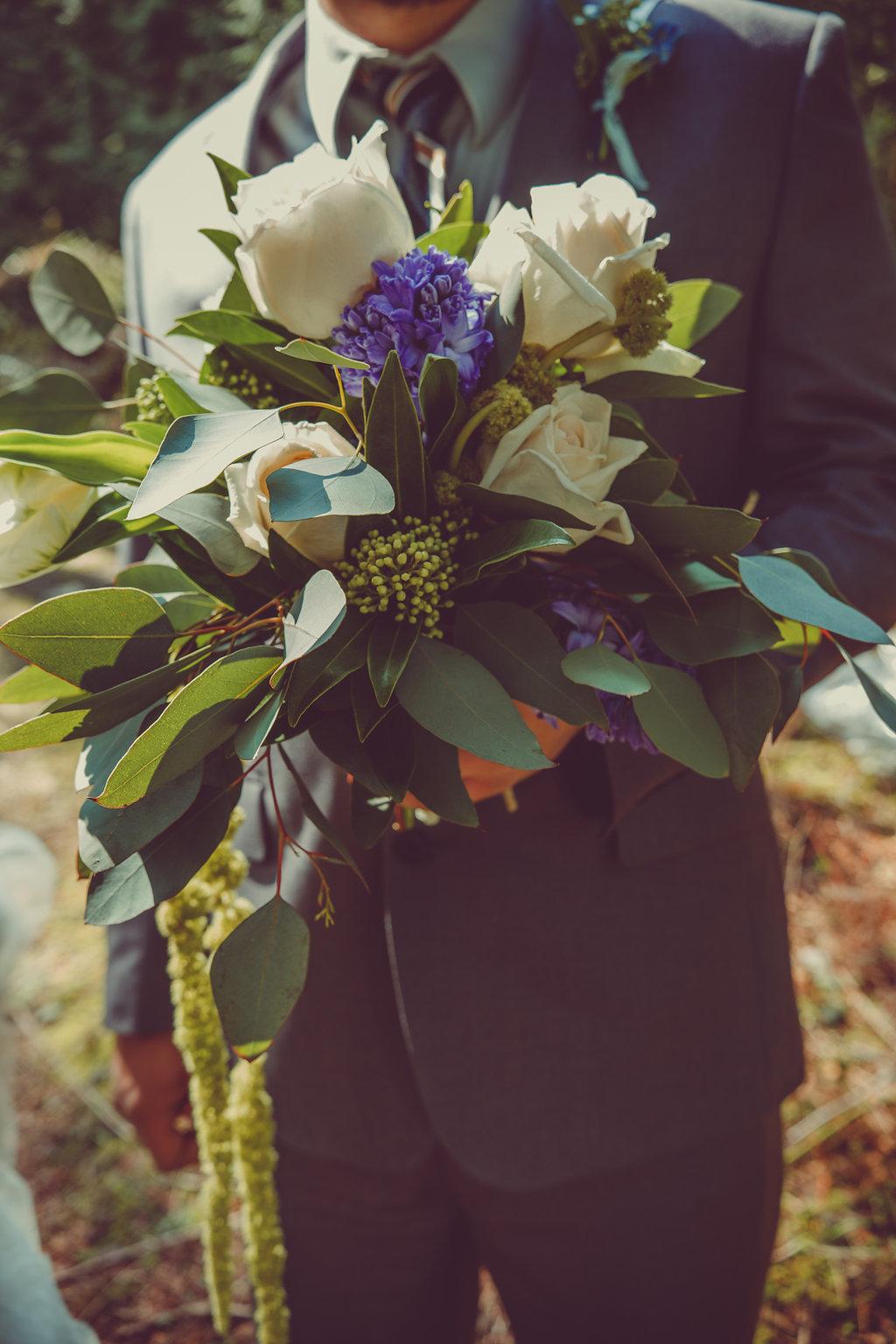 Groom Carrying Bouquet Nanimo West Coast Weddings Magazine