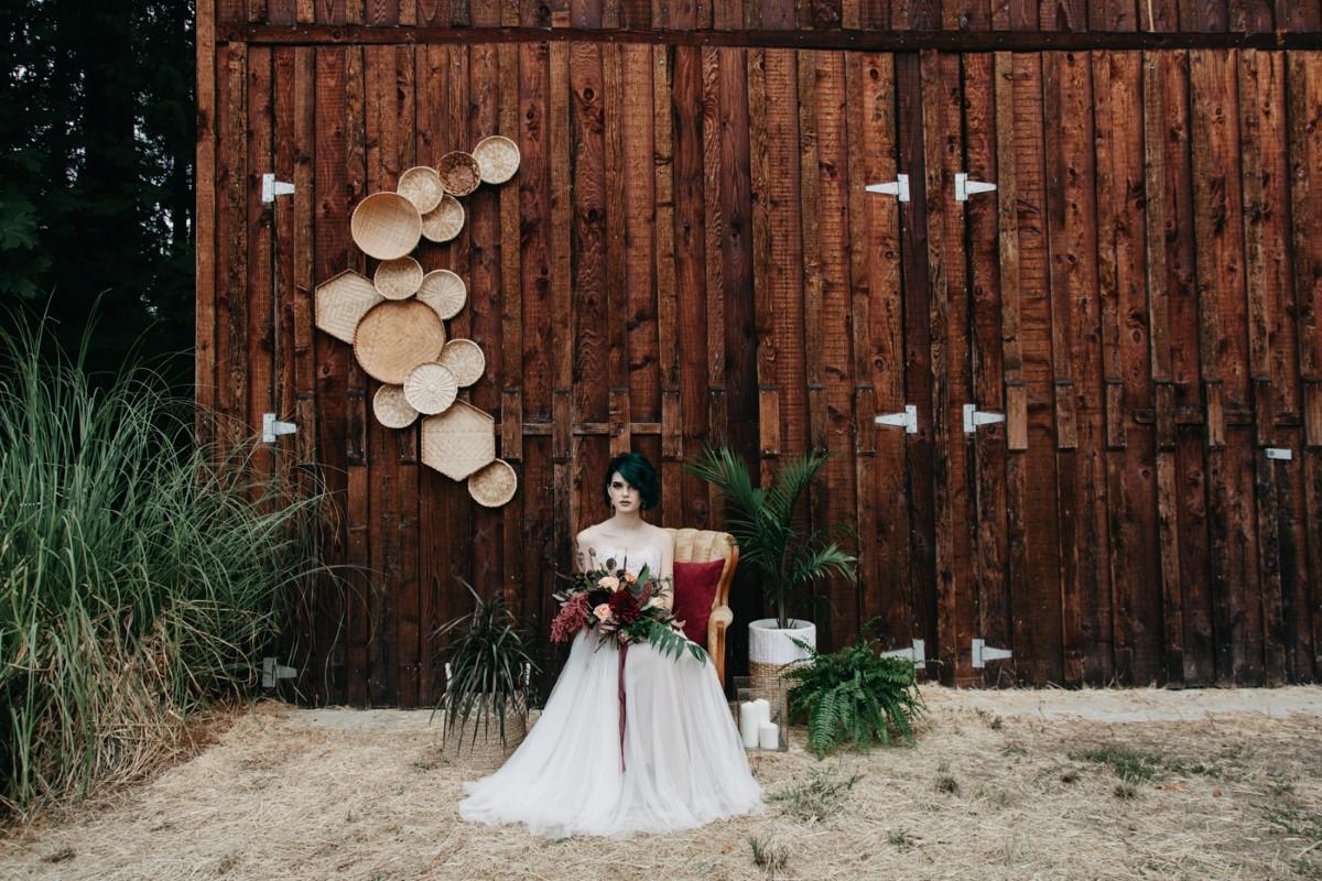 Bride framed by barn Inked + Pretty Brides West Coast Weddings Magazine