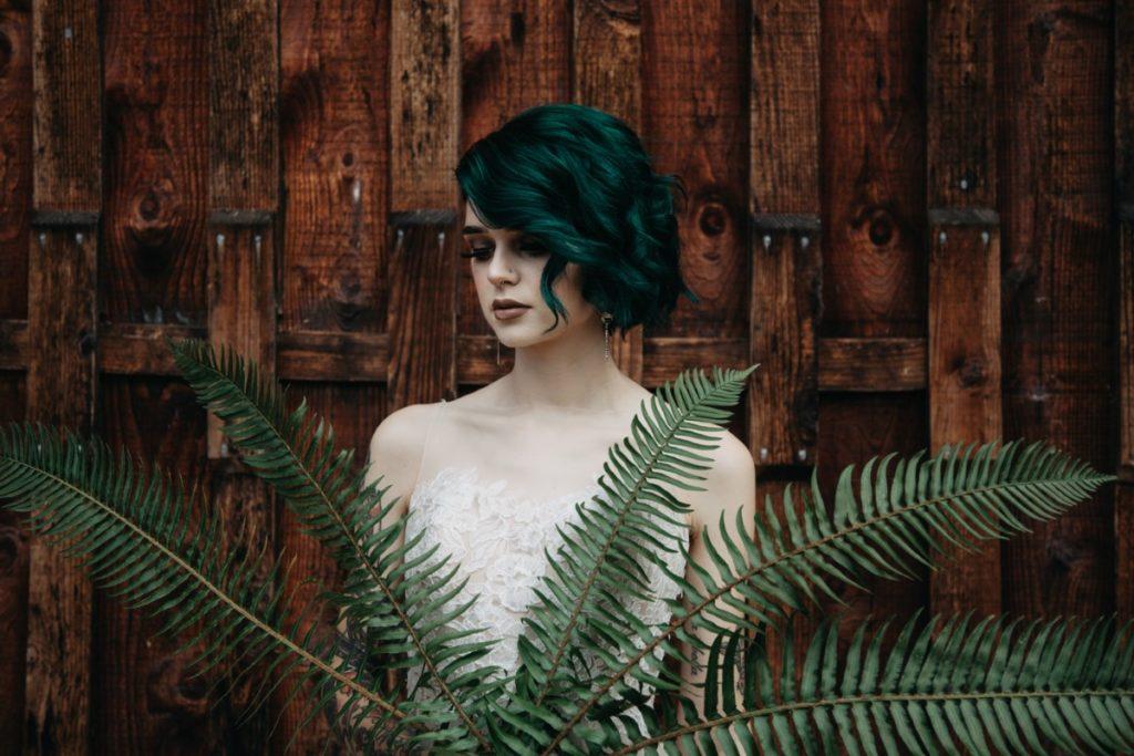 Bride holding ferns Inked + Pretty Brides West Coast Weddings Magazine