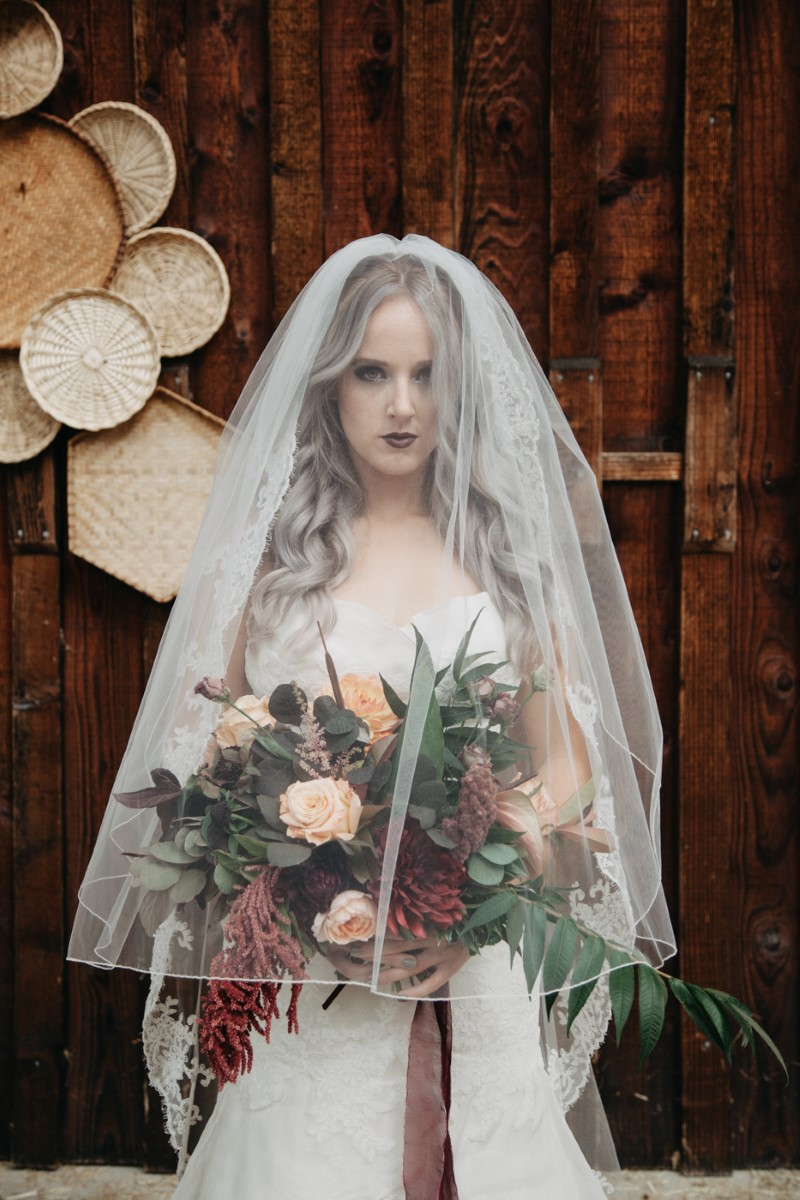 Bride with Veil over face Inked + Pretty Brides West Coast Weddings Magazine