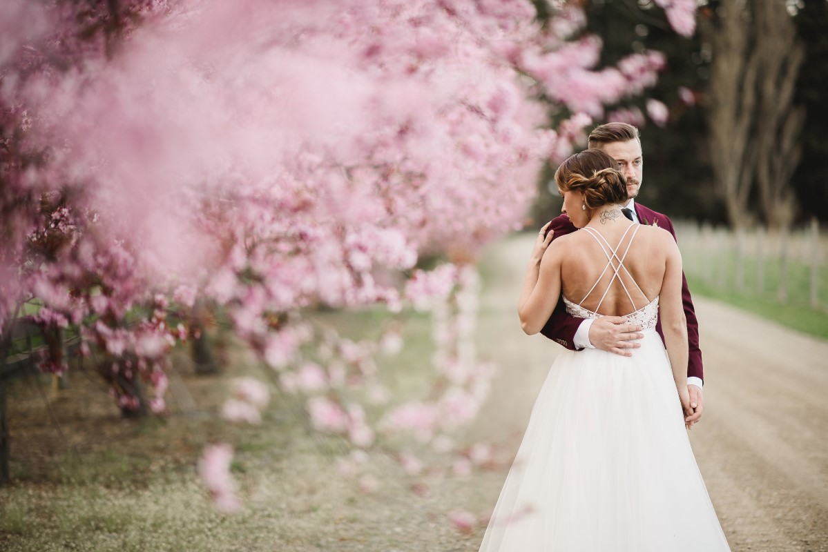 Pink Cherry Blossom Ceremony Circle Arch   Erin Wallis Photography   Sublime Celebrations   Karen Bezaire   Shelter Point Distillery   The White Peony   Jims Clothes Closet   Purely Flower   Headquarters Hair Studio   Eden Street Spa   West Coast Weddings Magazine