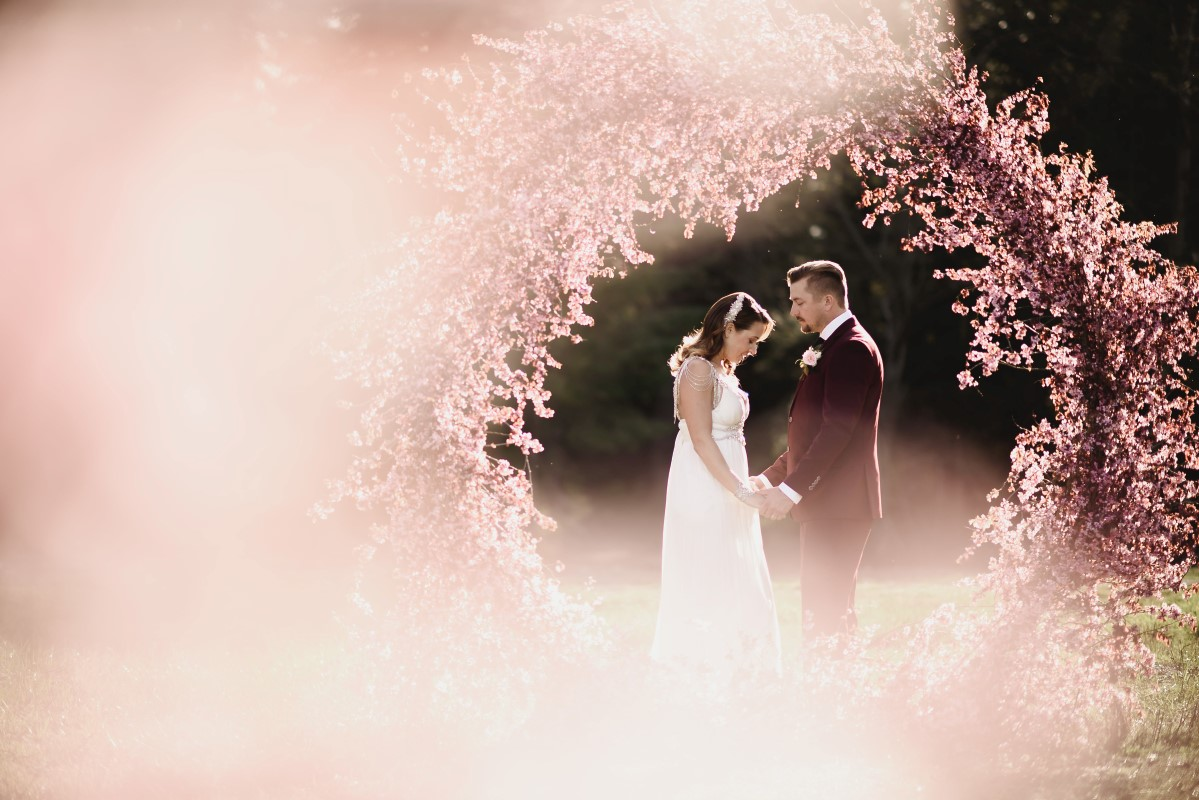 Cherry Blossom Ceremony Circle Arch | Erin Wallis Photography | Sublime Celebrations | Karen Bezaire | Shelter Point Distillery | The White Peony | Jims Clothes Closet | Purely Flower | Headquarters Hair Studio | Eden Street Spa | West Coast Weddings Magazine