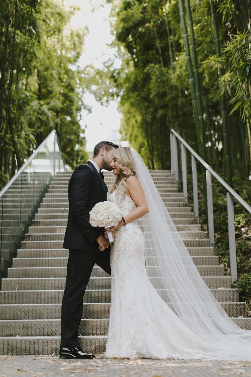 Kissing Kayseeb abd Stevan Silk Sophistication Ophelia Photography Vancouver West Coast Weddings Magazine
