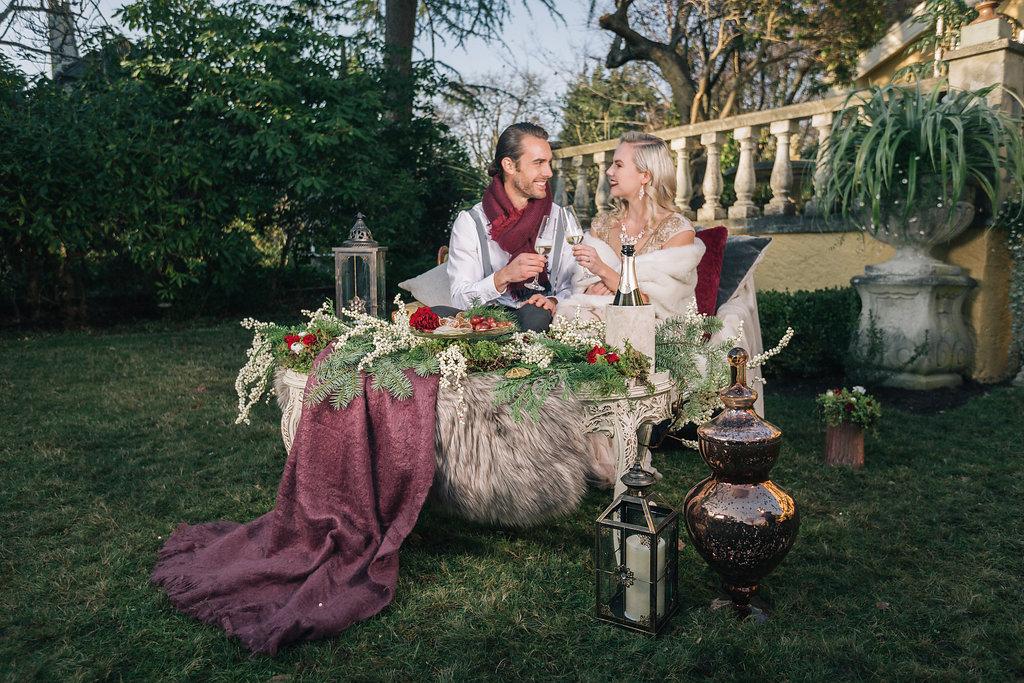 Couple sitting at outdoor decor table West Coast Weddings Magazine