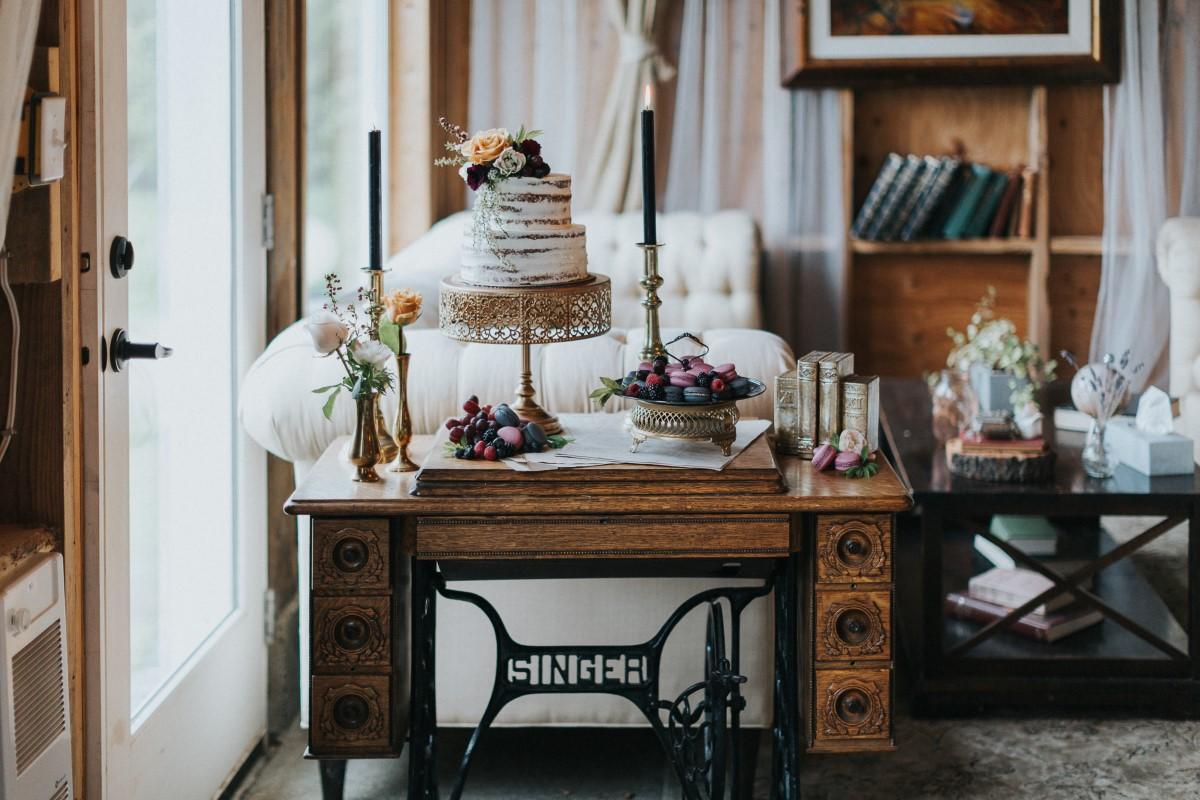 Singer sewing machine with wedding cake Moody Blue Romance Summer Rayne Photo West Coast Weddings Magazine