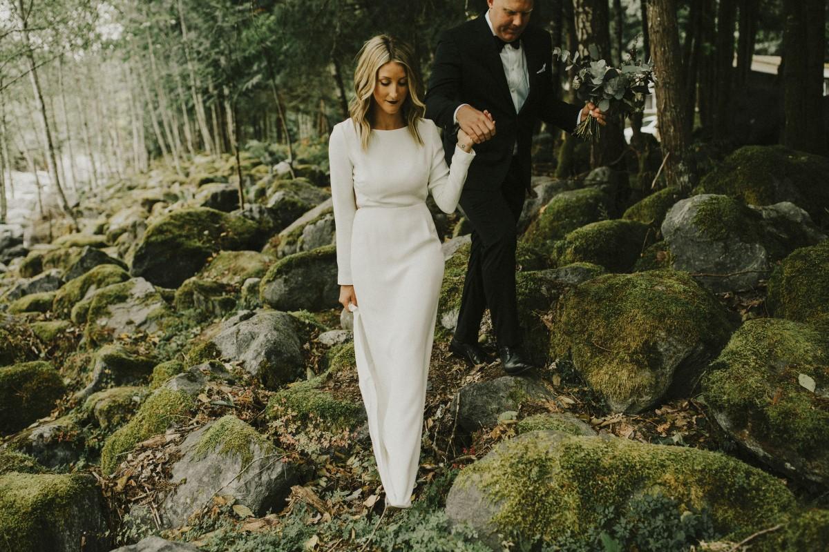 Bride and Groom Walking in Forest Elegant Woodland West Coast Weddings Magazine Vancovuer