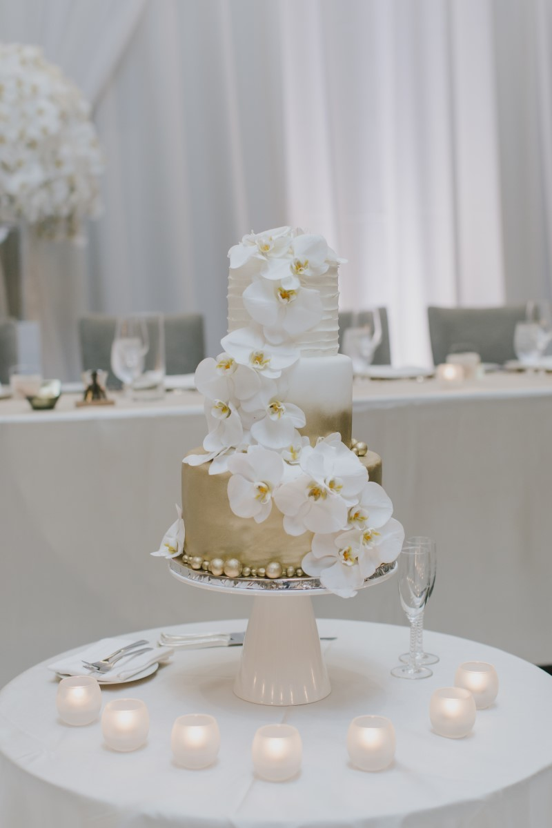 White Orchid Cake Table Kayseeb abd Stevan Silk Sophistication Ophelia Photography Vancouver West Coast Weddings Magazine