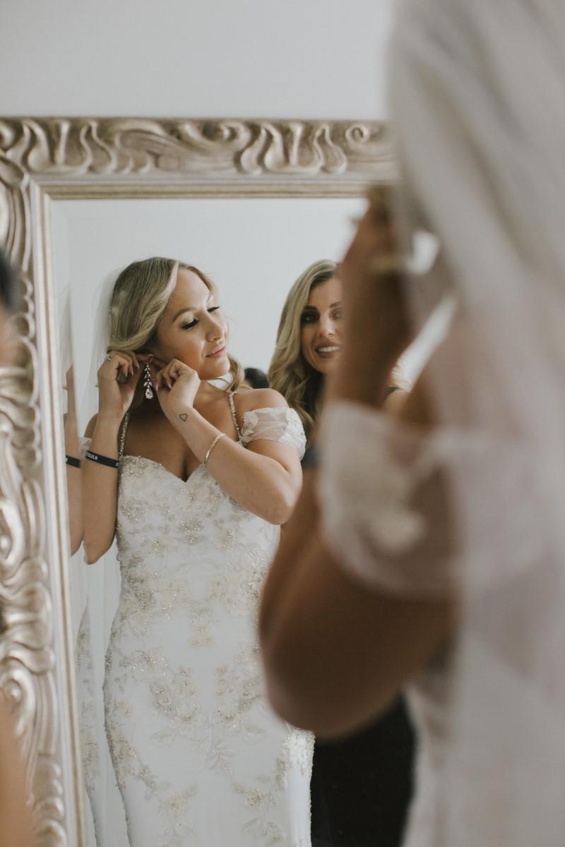 Bride in Mirror Kayseeb abd Stevan Silk Sophistication Ophelia Photography Vancouver West Coast Weddings Magazine