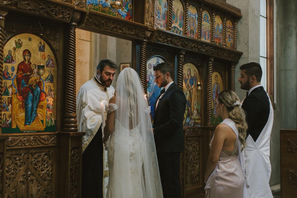 Bride and Groom Blessed by Greek Orthodox Priest Kayseeb abd Stevan Silk Sophistication Ophelia Photography Vancouver West Coast Weddings Magazine