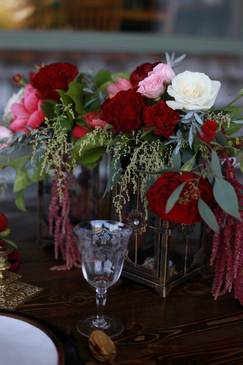 Burgandy Flowers on Champagne Reception Table West Coast Weddings Magazine