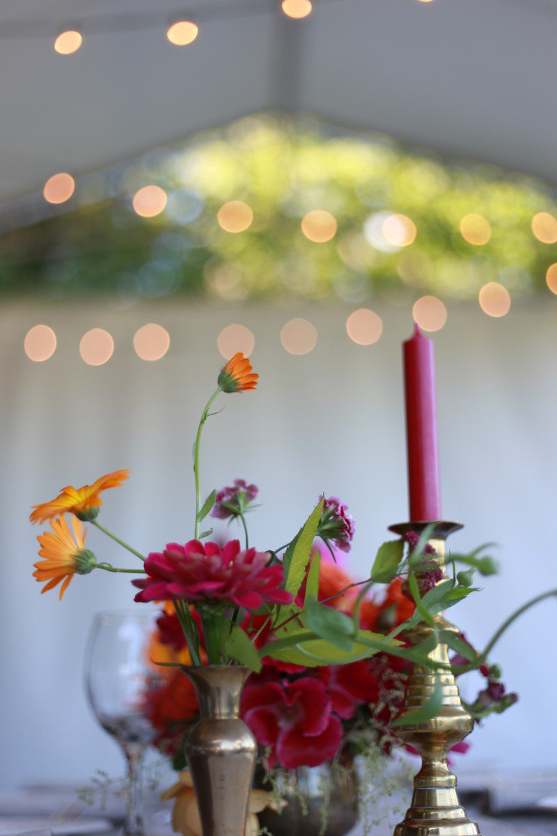 Red Roses and Candlesticks in Reception Tent Champagne Wedding Vancouver Island