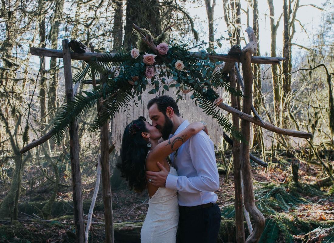 Newlyweds at Cermony Arch by Elyse Anna Photography West Coast Weddings Magazine
