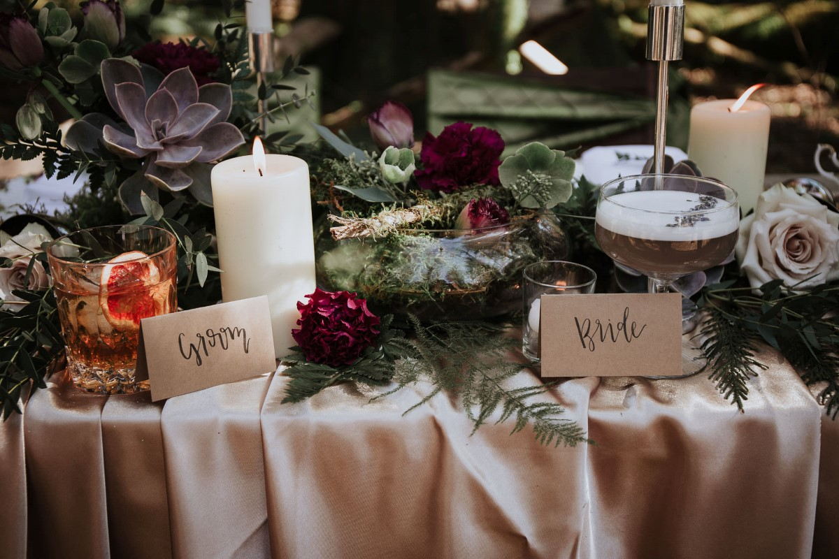 Sun Dappled Candles on Woodland Table by Fierce Florist West Coast Weddings Magazine