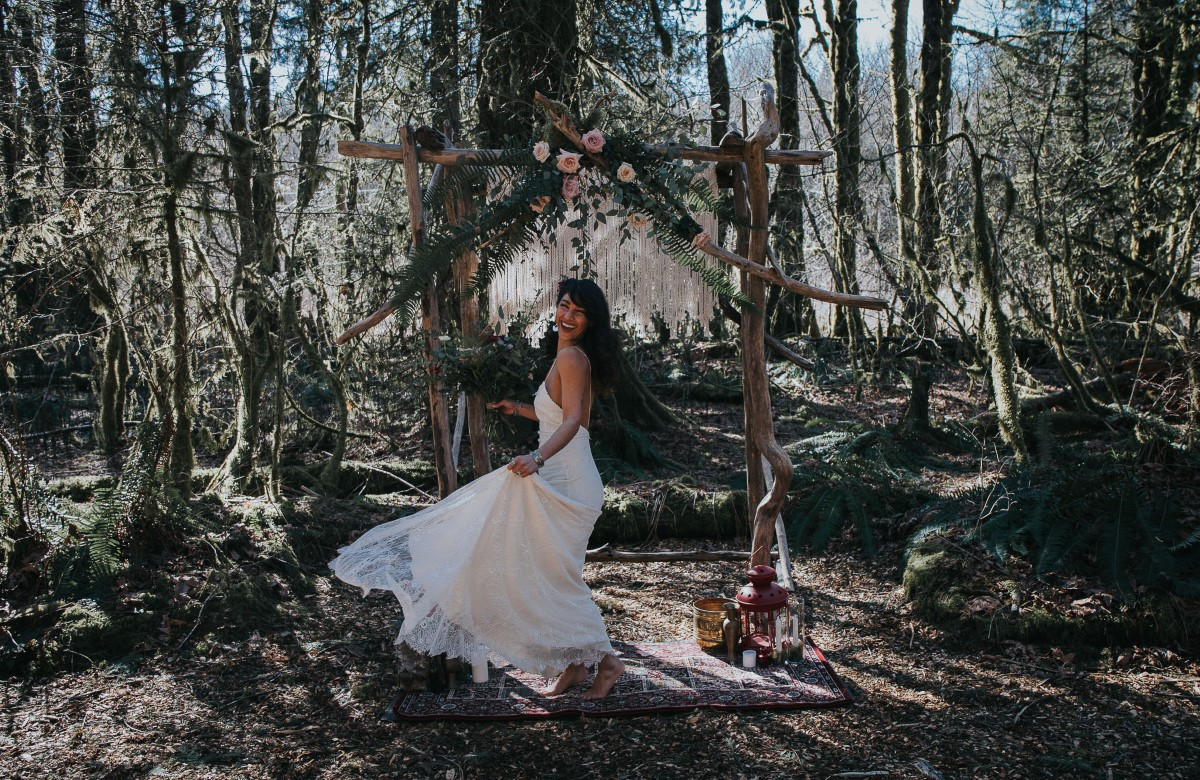Sun Dappled Pure Magnolia Bride dancing in Woodland Forest West Coast Weddings Magazine