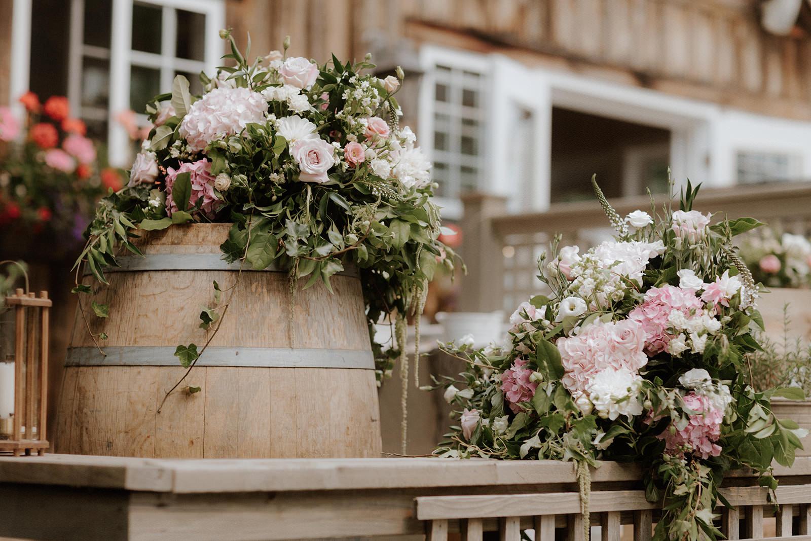 Rustic Floral Arrangements on Wine Barrels Anvil Island Wedding