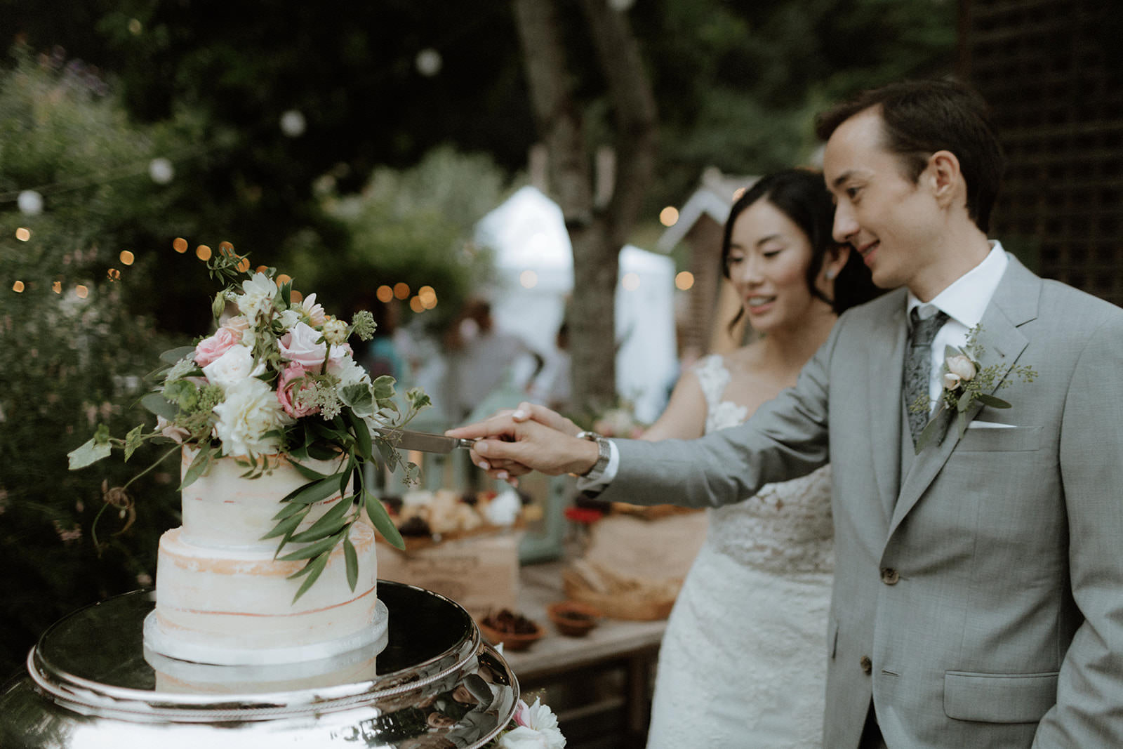 Cake Cutting at Rustic Anvil Island Wedding in British Columbia West Coast Weddings Magazine