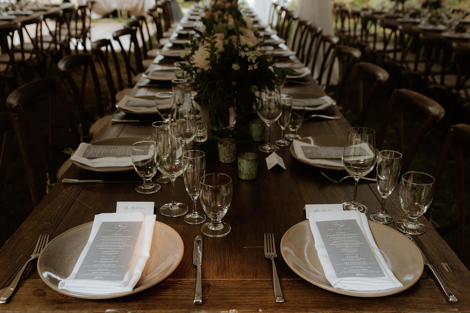 Long tables set with rustic elegant decor Tomasz Wagner PHotography BC Wedding Magazine