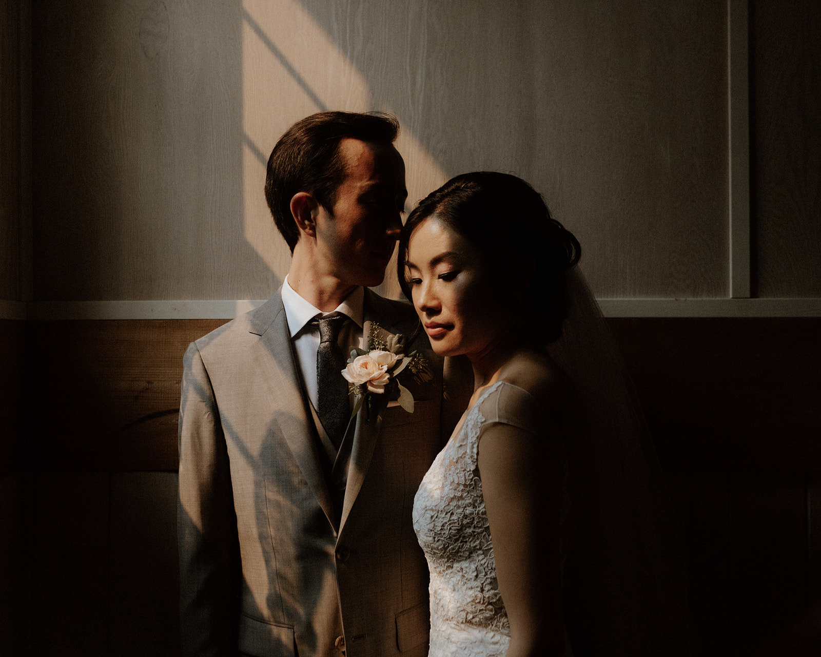 Posed Newlyweds in Shadow at Rustic Anvil Island Wedding by Vancouver Bon Vivant Group