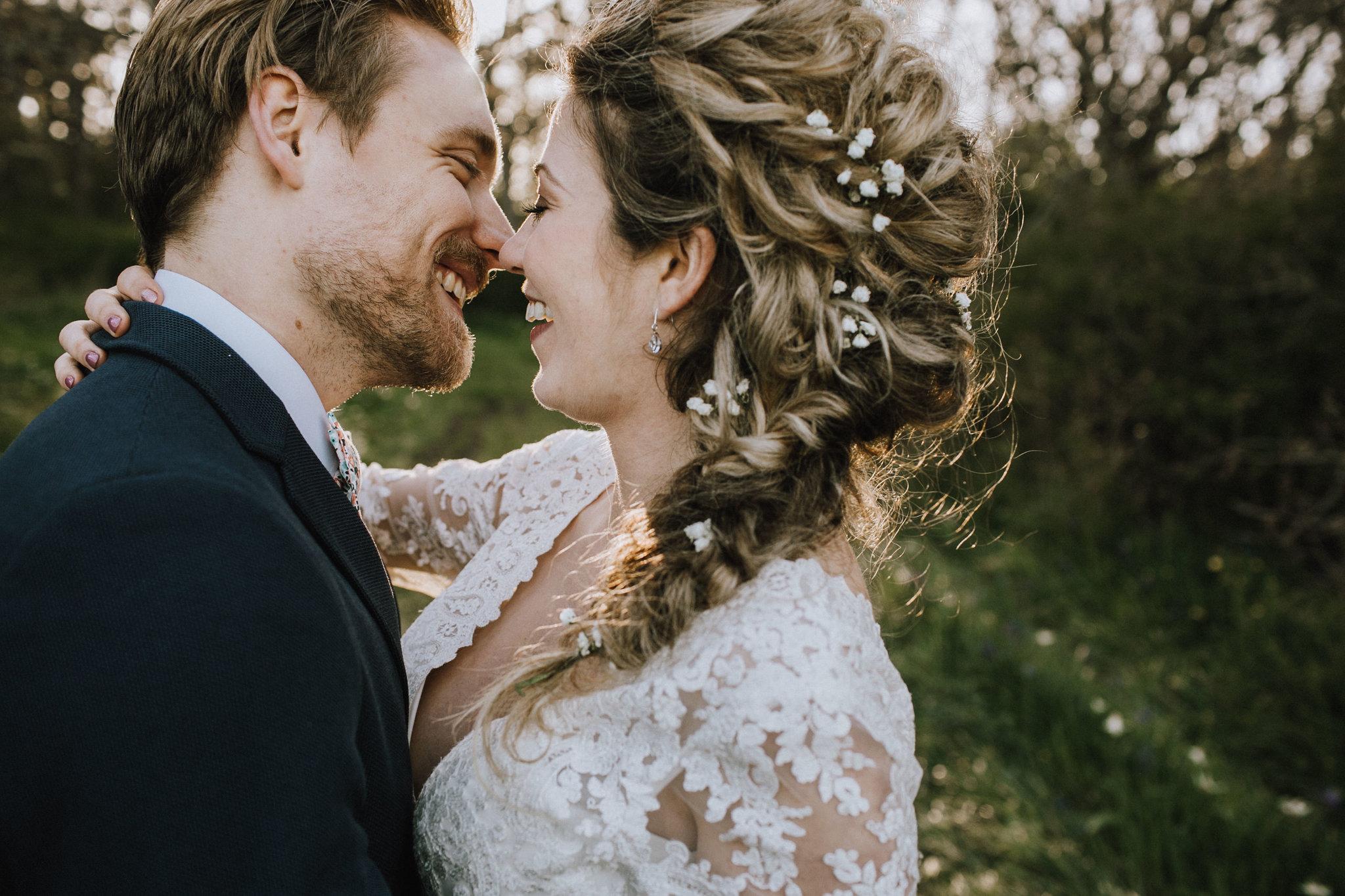 Beach Bridal Session with Couple Kissing Braid in Hair West Coast Weddings Magazine