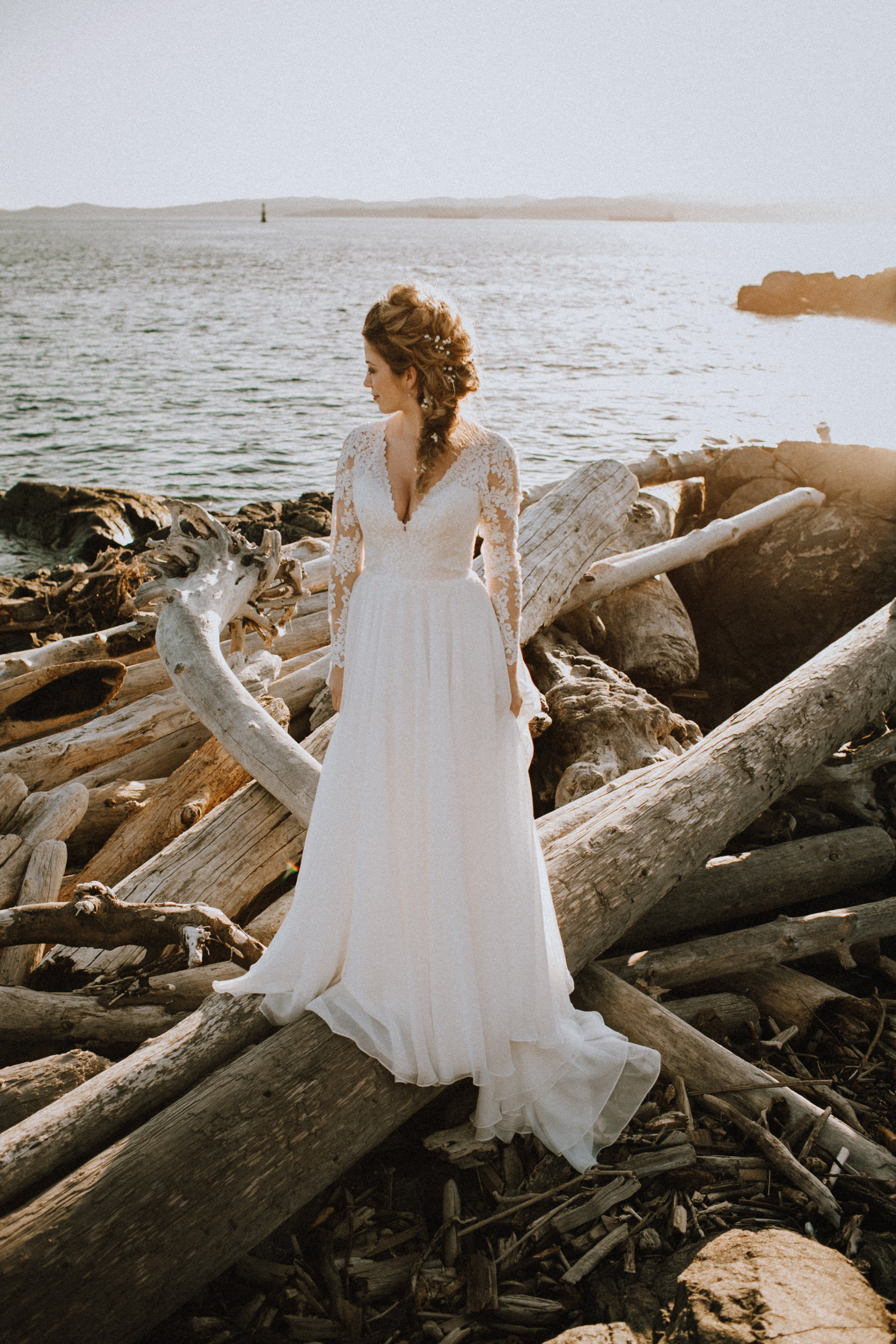 Beach Bridal Session with Wedding Gown on Beach with Driftwood
