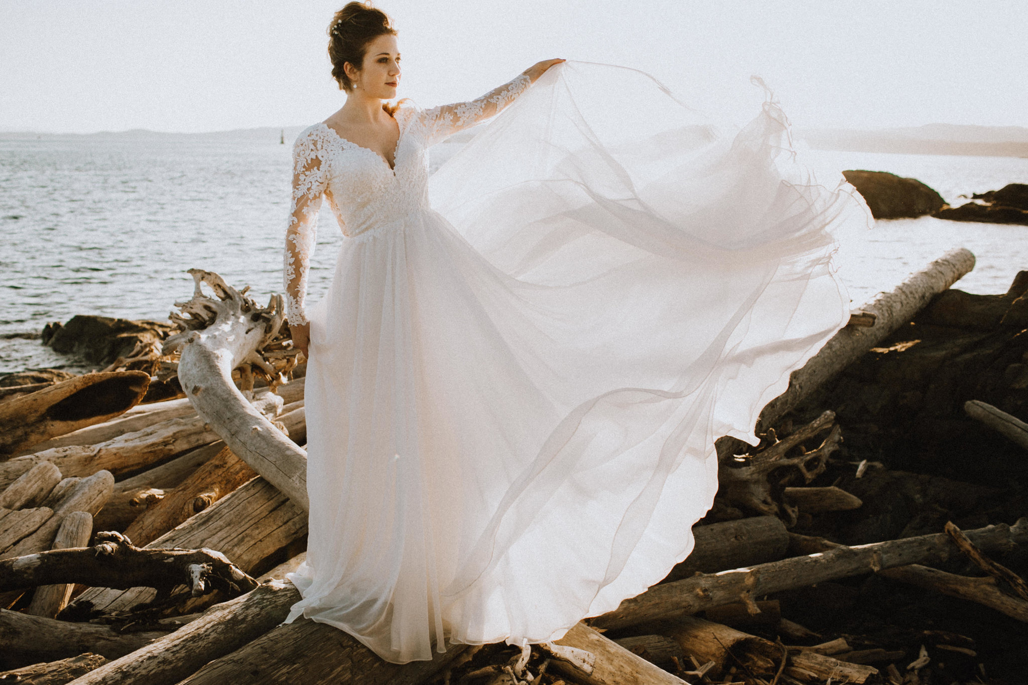 Lis Simon Gown at Beach Bridal Session Skirt in the Wind
