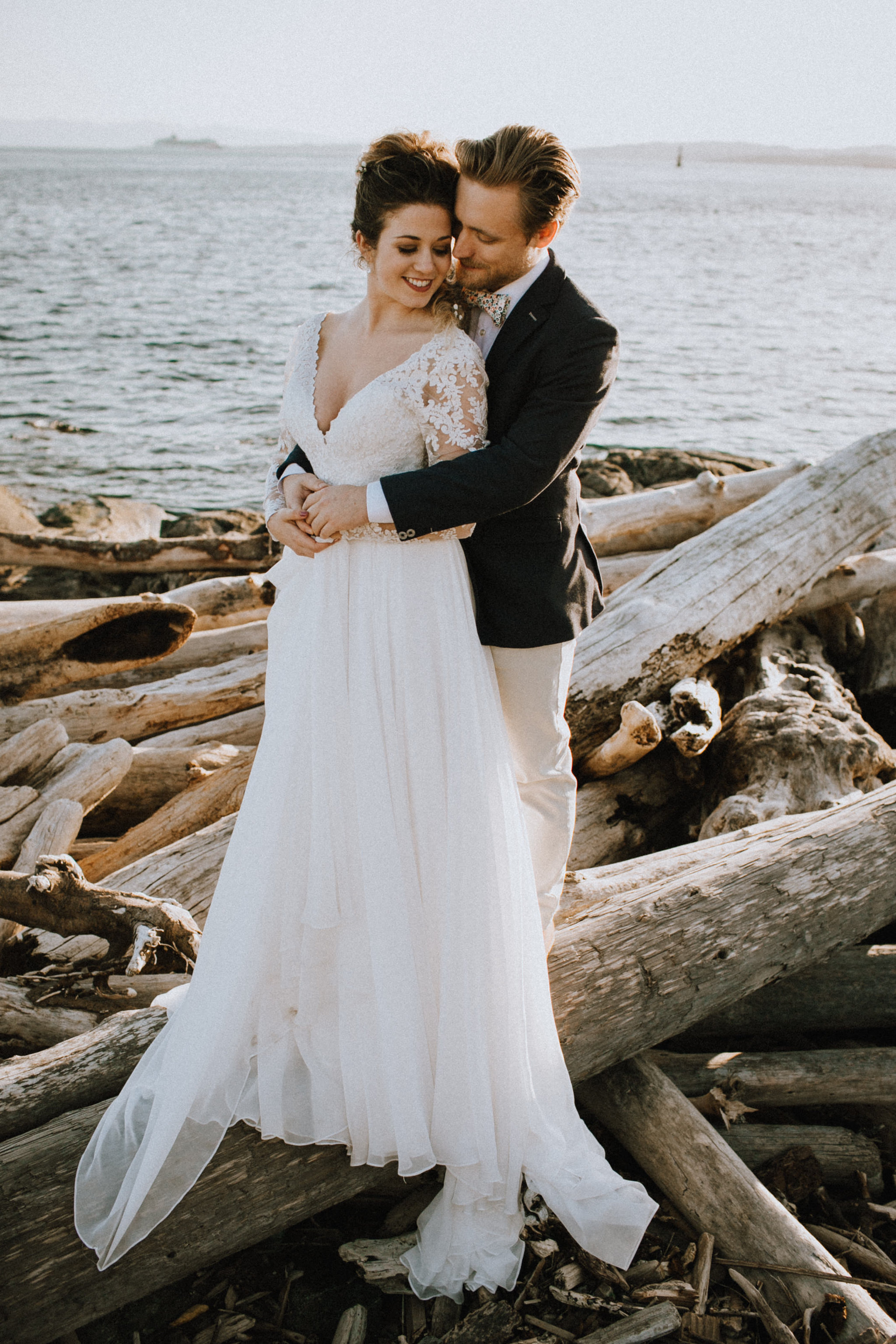 Beach Bridal Session with Wedding Couple on Beach with Driftwood Vancouver Island