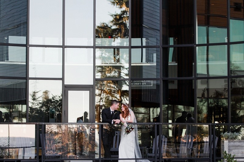 Newlyweds on Balcony at Black Rock Oceanfront Resort on Vancouver Island