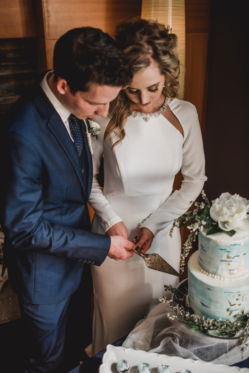 Couple Cutting by Cake by Taryn at Brentwood Bay Resort & Spa on Vancouver Island West Coast Weddings Magazine