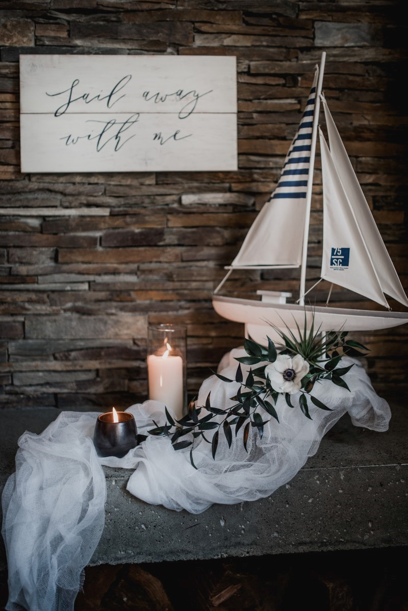 Nautical Reception Theme Sailboat on Guest Table Tulle and Tweed Photography West Coast Weddings Magazine